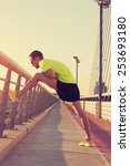 stretching after jogging on a... | Shutterstock . vector #253693180