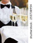 full glasses of champagne on... | Shutterstock . vector #253738954