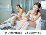 beautiful girl shaving her legs ... | Shutterstock . vector #253809469