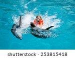 little laughing girl swimming... | Shutterstock . vector #253815418