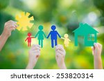 paper house and family in hands ... | Shutterstock . vector #253820314