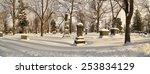 Gravestones Shrouded In Snow.