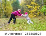 woman with girl doing aerobics... | Shutterstock . vector #253860829