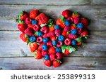 heart of berries on wooden... | Shutterstock . vector #253899313