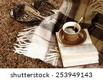 Woolen plaid, coffee cup, book and slippers on shaggy carpet. Top view. - stock photo