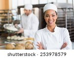 pretty baker smiling at camera... | Shutterstock . vector #253978579