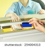 teller window with working... | Shutterstock . vector #254004313