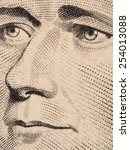 Small photo of Alexander Hamilton face extreme macro on US 10 dollar bill, united states money closeup, 2013 series