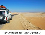 EGYPT, SAHARA - DEC 26, 2008: Off-road car shown on the road in the Tent valley desert. Extreme desert safari is one of the main local tourist attraction in Egypt - stock photo