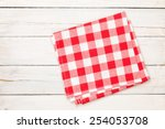 Постер, плакат: Red towel over wooden