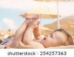 Happy Baby On The Beach Sunbed. ...