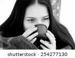 Beautiful Girl Drinking Tea Or...