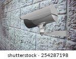 cctv camera against grey brick... | Shutterstock . vector #254287198