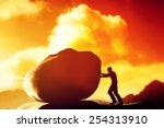 Man Pushing A Giant  Heavy...