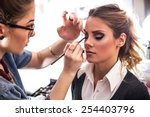 make up artist work on her... | Shutterstock . vector #254403796