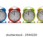 Four Colorful Alarm Clocks...
