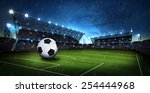 soccer ball on field with rain... | Shutterstock . vector #254444968