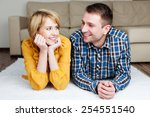 Happy couple at home smiling to each other - stock photo