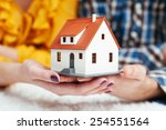 Close-up of young couple holding house miniature - stock photo