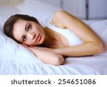 pretty woman lying  in bed | Shutterstock . vector #254651086