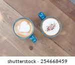 two cups of coffee  on wooden... | Shutterstock . vector #254668459