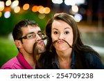 Couple Having Fun In Street At...