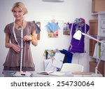 young fashion designer working... | Shutterstock . vector #254730064
