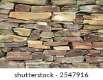 Loose stacked stone wall. - stock photo