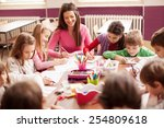 pupil boys and girls sitting... | Shutterstock . vector #254809618