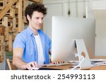 man in casual wear working in... | Shutterstock . vector #254993113