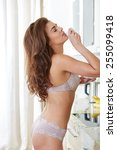 woman in lingerie posing in the ...   Shutterstock . vector #255099418