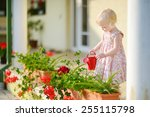cute little girl watering... | Shutterstock . vector #255115798
