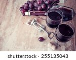 red wine and grapes in vintage...