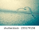 heart water drop on blue light...   Shutterstock . vector #255179158