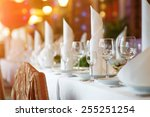 tables set and salad served for ... | Shutterstock . vector #255251254
