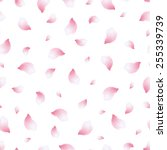 Stock vector beautiful light spring background seamless pattern with pink flying petals of sakura japanese 255339739