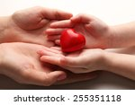 heart in child and mother hands ... | Shutterstock . vector #255351118