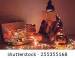 girl reading a book under...   Shutterstock . vector #255355168