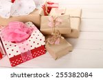 beautiful gift boxes on wooden... | Shutterstock . vector #255382084