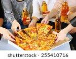 friends hands with bottles of... | Shutterstock . vector #255410716