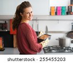 happy young housewife holding... | Shutterstock . vector #255455203
