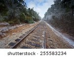 old railroad tracks with ice... | Shutterstock . vector #255583234