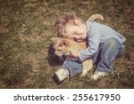 young boy hugging his cat.... | Shutterstock . vector #255617950