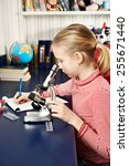 girl uses a microscope and... | Shutterstock . vector #255671440