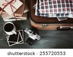 vintage suitcase with clothes... | Shutterstock . vector #255720553