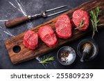 Raw fresh marbled meat Steak and seasonings on dark marble background