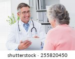 smiling male doctor writing... | Shutterstock . vector #255820450