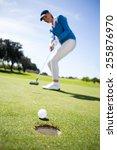 female golfer putting her ball... | Shutterstock . vector #255876970