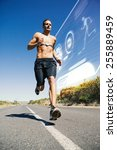 athletic man jogging on open... | Shutterstock . vector #255889459