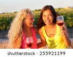 Happy Women Friends Drinking...